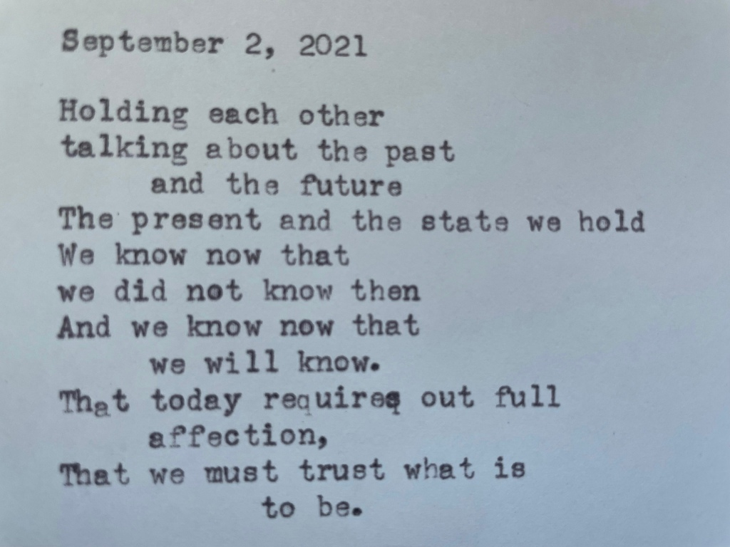 a picture of the poem, typewritten with a typewriter, on a white piece of paper.